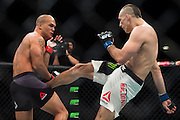 Rory MacDonald throws a kick against Robbie Lawler during UFC 189 at the MGM Grand Garden Arena in Las Vegas, Nevada on July 11, 2015. (Cooper Neill)