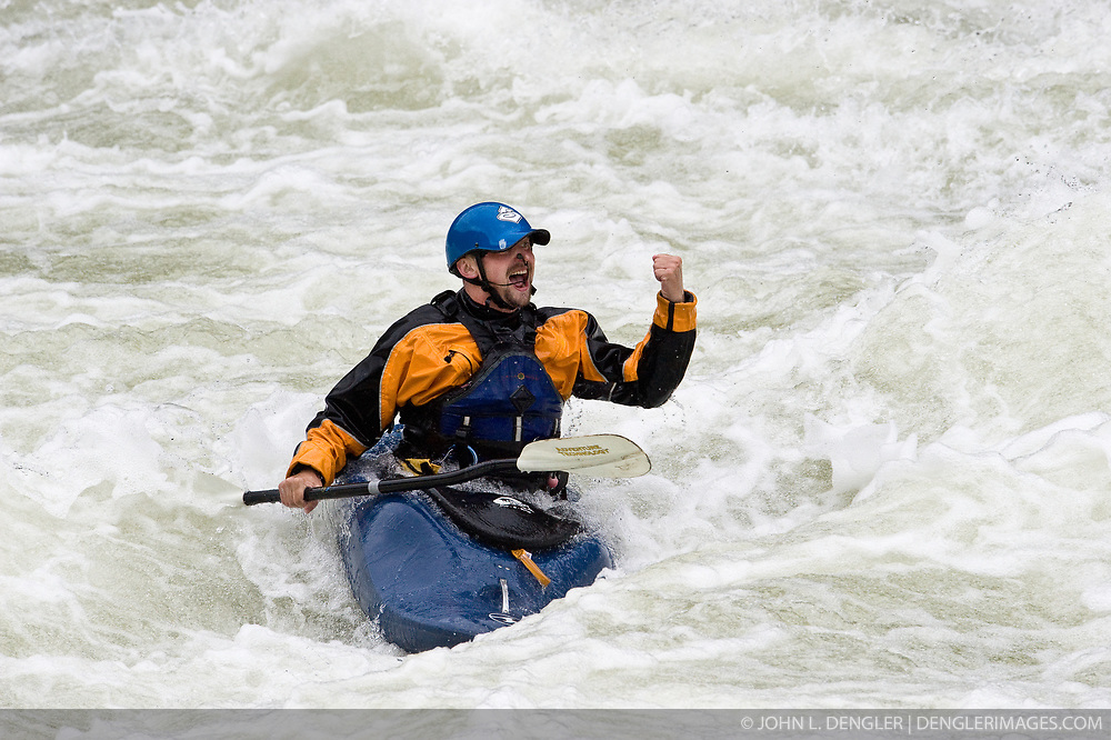 An unidentified whitewater kayaker celebrates after going through the rapids at Sweet's Falls on the Gauley River during American Whitewater's Gauley Fest weekend. The upper Gauley, located in the Gauley River National Recreation Area is considered one of premier whitewater rivers in the country.