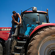 Alan Stoner, 21, prepares a tractor for transportation from Crowell, TX to the next wheat harvest in Oklahoma. May 2017.