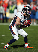 Denver Broncos kick returner Wes Welker (83) returns a first quarter punt during the NFL week 15 regular season football game against the San Diego Chargers on Sunday, Dec. 14, 2014 in San Diego. The Broncos won the game 22-10. ©Paul Anthony Spinelli