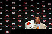 DALLAS, TX - JULY 21:  Oklahoma State head coach Mike Gundy speaks during the Big 12 Media Day on July 21, 2014 at the Omni Hotel in Dallas, Texas.  (Photo by Cooper Neill/Getty Images) *** Local Caption *** Mike Gundy