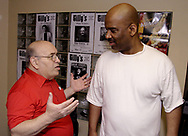 Jerry Gillotti (left) talks with Walter Beasley at Gilly's Niteclub in Dayton, Friday, May 11th.