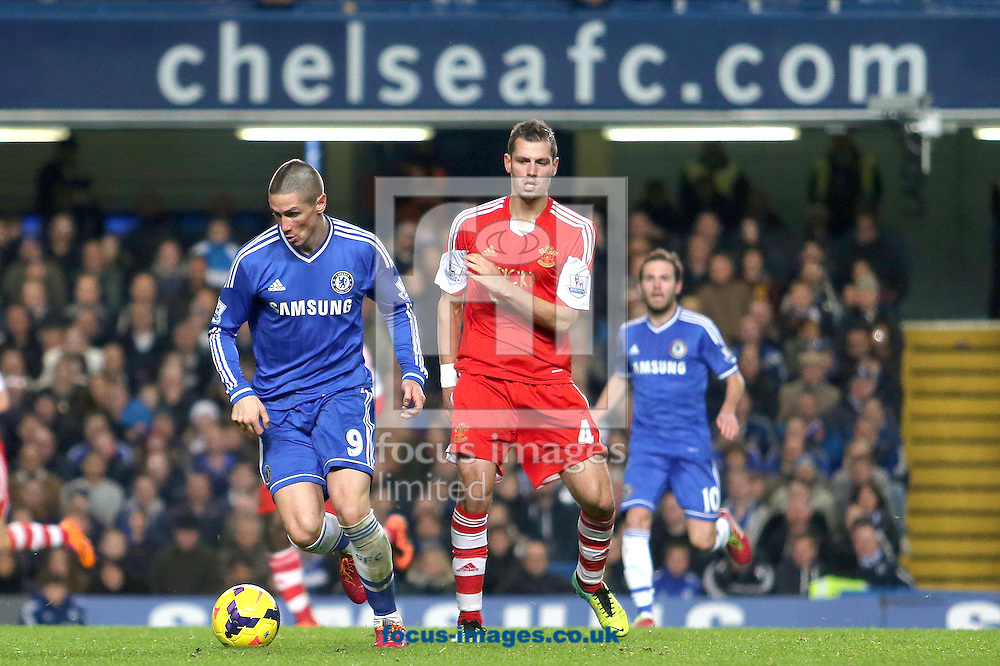 Picture by Richard Calver/Focus Images Ltd +447792 981244<br /> 01/12/2013<br /> Fernando Torres of Chelsea and Morgan Schneiderlin of Southampton during the Barclays Premier League match at Stamford Bridge, London.