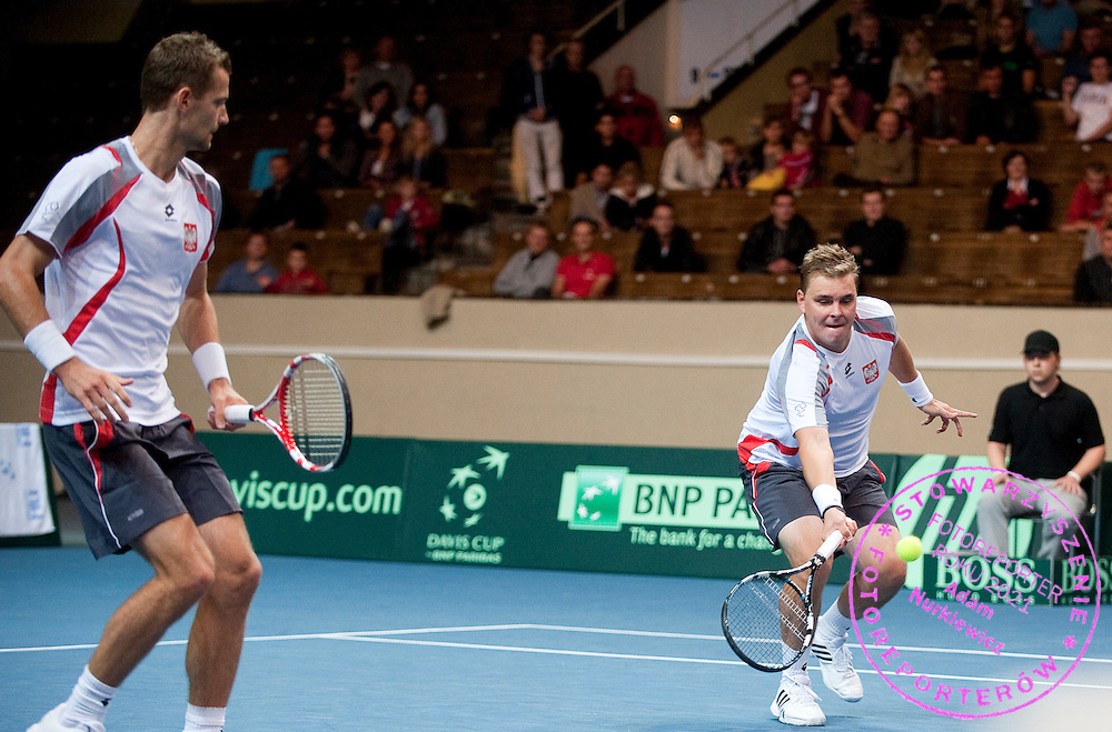 (L) Mariusz Fyrstenberg & (R) Marcin Matkowski both from Poland compete at men's double game during the BNP Paribas Davis Cup 2012 between Poland and Belarus at MOSiR Hall in Lodz on September 15, 2012...Poland, Lodz, September 15, 2012..Picture also available in RAW (NEF) or TIFF format on special request...For editorial use only. Any commercial or promotional use requires permission...Photo by © Adam Nurkiewicz / Mediasport