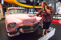 © Licensed to London News Pictures. 17/06/2015. London, UK. Elvis Presley's Pink Cadillac from Graceland is unveilled for display at Elvis at the O2: The Exhibition of his Life in London today.  Photo credit : Vickie Flores/LNP