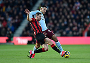 Dan Gosling (4) of AFC Bournemouth battles for possession with Anwar El Ghazi (21) of Aston Villa during the Premier League match between Bournemouth and Aston Villa at the Vitality Stadium, Bournemouth, England on 1 February 2020.