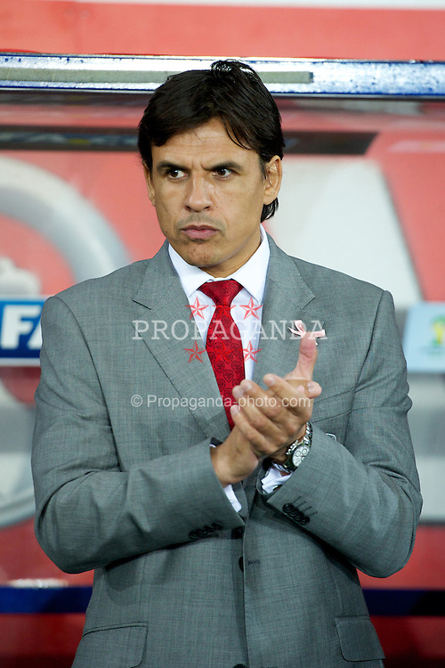 CARDIFF, WALES - Friday, October 12, 2012: Wales' manager Chris Coleman wearing a pink ribbon for missing five-year girl from Machynlleth April Jones before the Brazil 2014 FIFA World Cup Qualifying Group A match against Scotland at the Cardiff City Stadium. (Pic by David Rawcliffe/Propaganda)