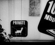 """Sign advertises private booths at a """"mangakissa"""" internet comic cafe, Kabuki-cho, Tokyo, Japan."""