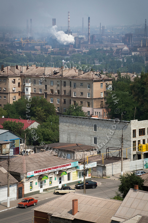 The industrial town of Mariupol, Ukraine, on the Azov Sea, is photographed from the rooftop of an apartments' tower.