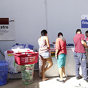 DECEMBER 1, 2017---HUMACAO, PUERTO RICO--<br /> Students and staff doing their laundry using loaner washer/dryers set up at the University of Puerto Rico's Humacao campus. Hurricane Maria damaged a lot of the structures and the school runs on generators since the power has not been restored.<br /> (PHOTO BY ANGEL VALENTIN/FREELANCE)