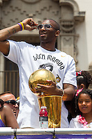 21 June 2010: Kobe Bryant of the Los Angeles Lakers waves while holding the Larry O'Brien Championship Trophy during the Lakers Championship Victory Parade on Figueroa BL. in Los Angeles, CA after the Lakers won the 2010 NBA Championship over the Boston Celtics in Game 7 of the NBA Finals.