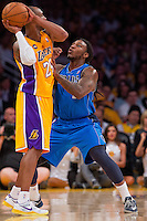 02 April 2013: Guard (24) Kobe Bryant of the Los Angeles Lakers looks to pass while being guarded by Jae Crowder of the Dallas Mavericks during the first half of the Lakers 101-81 victory over the Mavericks at the STAPLES Center in Los Angeles, CA.