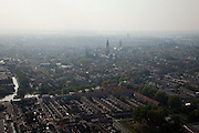 Nederland, Zuid-Holland, Delft, 19-09-2009; de kerktorens en de binnenstad in de mist en nevel, de Oostsingel in de voorgrond;.church towers and the town in the fog and mist, the Oostsingel in the foreground.luchtfoto (toeslag), aerial photo (additional fee required).foto/photo Siebe Swart