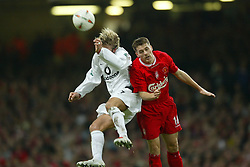 CARDIFF, WALES - Sunday, March 2, 2003: Liverpool's Michael Owen and Manchester United's David Beckham during the Football League Cup Final at the Millennium Stadium. (Pic by David Rawcliffe/Propaganda)