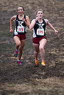 Kenai Central High School teammates Riana Boonstra, left, and Addison Gibson sprint to the finish line during the Region III Cross Country Championships at GPRA on Saturday. Gibson held off Boonstra to win the Region III large school individual title, and the 1-2 finish helped the Kenai Central girls defend their team title.