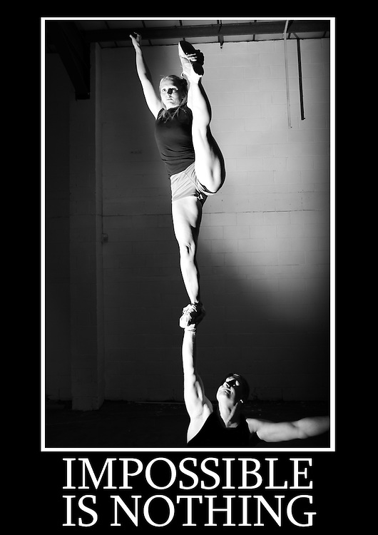 Motivational cheerleading poster of a single based partner stunt one armed lib with flyer doing a heal stretch. Caption underneath reads &quot; Impossible is nothing&quot;<br /> Measures 33 x 23.5 inches/A1     &pound;12.50