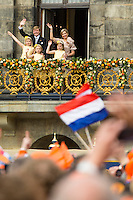 Newly-crowned Dutch King Willem-Alexander and Queen Maxima appear on the balcony of the Royal Palace with their children, from left: Catharina-Amalia, Ariane, and Alexia in Amsterdam, The Netherlands, on April 30, 2013.