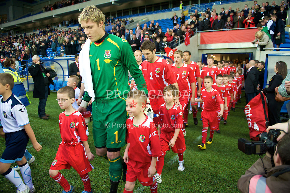 CARDIFF, WALES - Saturday, November 14, 2009: Wales' goalkeeper Wayne Hennessey walks out to face Scotland before the international friendly match at the Cardiff City Stadium. (Pic by David Rawcliffe/Propaganda)