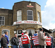 Picture by David Horn/Focus Images Ltd +44 7545 970036.27/04/2013.Fans relax in the sun before the Brentford v Doncaster Rovers npower League 1 match at Griffin Park, London.