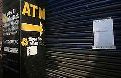 November 9, 2016 - Kolkata, West Bengal, India - Bank paste notice of closer in their gate. Business effected all over India as Union Government announcements to one day bank and ATM shut down around the nation due to withdraw of Rs. 500 and Rs. 1000 bank notes nationwide. (Credit Image: © Saikat Paul/Pacific Press via ZUMA Wire)