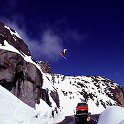 An image of a skier jumping over a truck on Donner Summit, Ca.