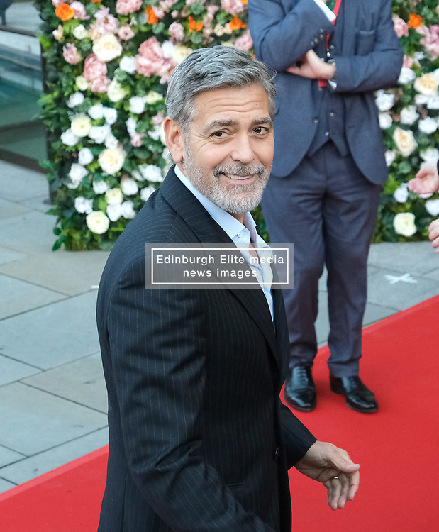 George Clooney and his wife Amal, representing the Clooney Foundation for Justice, arrive to collect an award for their charity work at the People's Postcode Lottery Charity Gala in Edinburgh <br /> <br /> Pictured: George Clooney <br /> <br /> (c) Aimee Todd   Edinburgh Elite media