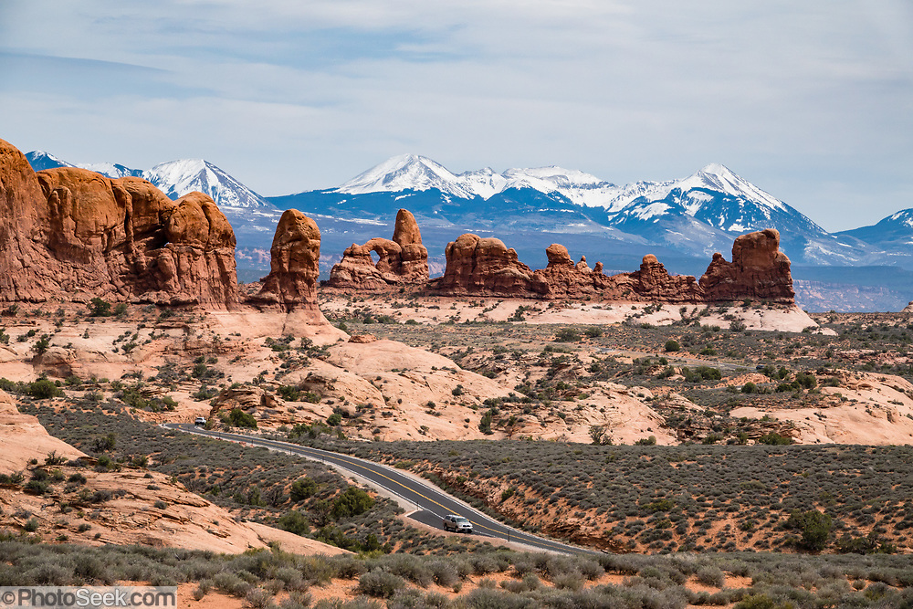 Turret Arch and La Sal Mountains. The Windows Section of Arches National Park, Moab, Utah, USA.