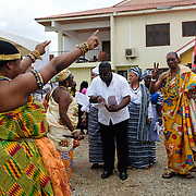 A traditional dancer welcoming dignitaries to the dais at a swearing-in ceremony for newly elected members of a council of Queen Mothers in Accra, Ghana on 23 June 2015. A queen mother is a traditional female leader, drawn from the relevant chiefly lineage, who is responsible for women's and children's issues in particular. Though often widely respected and sometimes powerful, especially in matrilineal ethnic groups, their authority is subject to a male chief. After being suppressed during the colonial era, the role of queen mother is being revived in Ghana and is seen by many as a force for development.