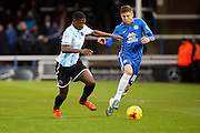 Shrewsbury Town FC midfielder Sullay Kaikai and Peterborough United midfielder Harry Beautyman challenge for the ball during the Sky Bet League 1 match between Peterborough United and Shrewsbury Town at the ABAX Stadium, Peterborough, England on 12 December 2015. Photo by Aaron Lupton.