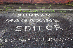 © Licensed to London News Pictures. 24/09/2012. London, UK. Image date 24/07/2012. Sunday Magazine Editor parking space at the former News International site (Fortress Wapping) car park in Pennington Street, East London.  On 27 September 2012 the entire site contents will be sold at an online auction. The former News International site was sold to Berkeley Group's, St George in May 2012 who have renamed it 'London Dock' and are planning redevelopment as mixed residential, retail and office use. Photo credit : Vickie Flores/LNP
