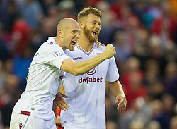 13.09.2014, Anfield, Liverpool, ENG, Premier League, FC Liverpool vs Aston Villa, 4. Runde, im Bild Aston Villa's Philippe Senderos and Nathan Baker celebrate their side's 1-0 victory over Liverpool // during the English Premier League 4th round match between Liverpool FC and Aston Villa at Anfield in Liverpool, Great Britain on 2014/09/13. EXPA Pictures &copy; 2014, PhotoCredit: EXPA/ Propagandaphoto/ David Rawcliffe<br /> <br /> *****ATTENTION - OUT of ENG, GBR*****