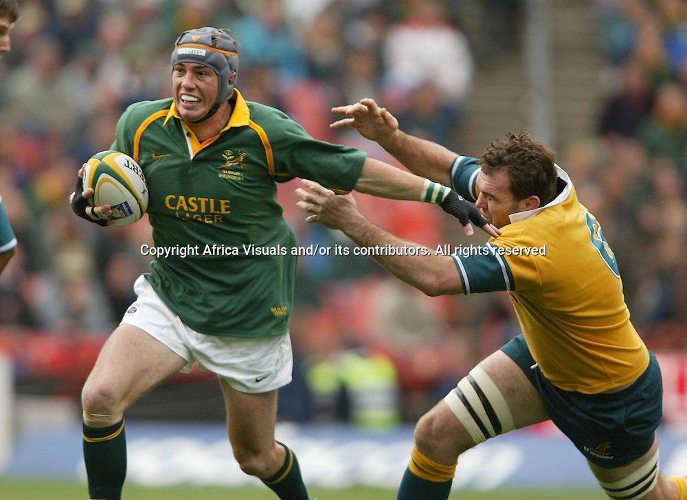 17 August 2002, Ellis Park, Tri - Nations, Rugby Union. South Africa v Australia. Marius Joubert gets past Owen Finegan. The Springboks defeated Australia, 33-31.<br />Pic: Noel Hammond/Photosport