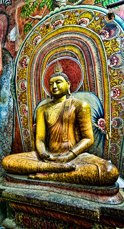 Seated Buddha with pretty colorful backdrop.<br /> (Photo by Matt Considine - Images of Asia Collection)