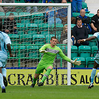 Hibs v St Johnstone...25.08.12   SPL<br /> Ben Williams blocks Gregory Tade as he is through on goal<br /> Picture by Graeme Hart.<br /> Copyright Perthshire Picture Agency<br /> Tel: 01738 623350  Mobile: 07990 594431