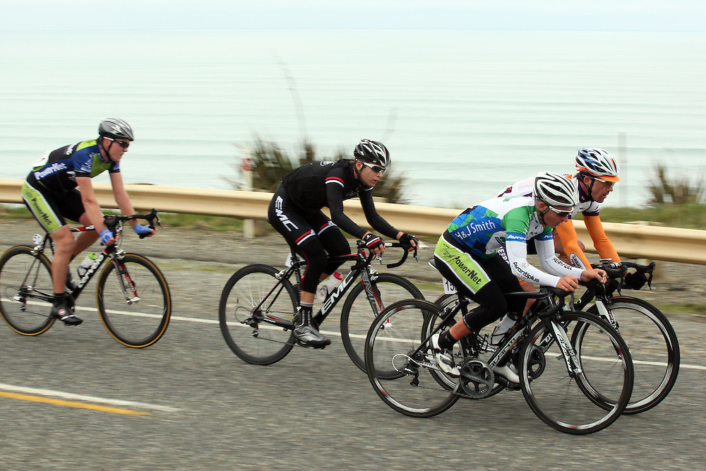 H&Js Outdoor World -Avanti Plus's Alexander Ray, Auckland, right front, and Share the Road's Brett Tivers race towards Tuatapere in stage three of the PowerNet Tour of Southland, Tuatapere, New Zealand, Wednesday, November 02, 2011. Credit:SNPA / Dianne Manson.