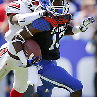 U of L cornerback Charles Gaines tries to tackle UK defensive back Jared Leet in the second quarter as the University of Kentucky plays the University of Louisville at Commonwealth Stadium in Lexington, Ky. Saturday Sept. 14, 2013. Photo by David Stephenson
