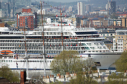 © Licensed to London News Pictures. 05/05/2016. The yard arms of the Cutty Sark are manned by 48 sailors to welcome Viking Sea to Greenwich. Brand new cruise ship Viking Sea has arrived in London for a christening ceremony at Greenwich. The 227 metre long cruise ship carries 930 passengers and is the biggest cruise ship to ever be christened in London. Credit : Rob Powell/LNP