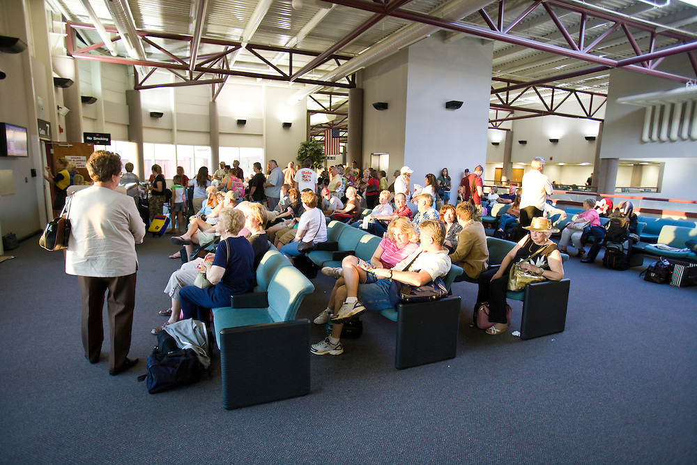 Passengers wait for their airplane at the Springfield-Branson National Airport in Springfield, MO.