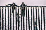 Pro migrant caravan demonstrators climb the U.S.-Mexico border fence during a rally in support of the migrant caravan in Mexico on Sunday, April 29, 2018 atthe U.S. Mexico Border in San Ysidro, California.