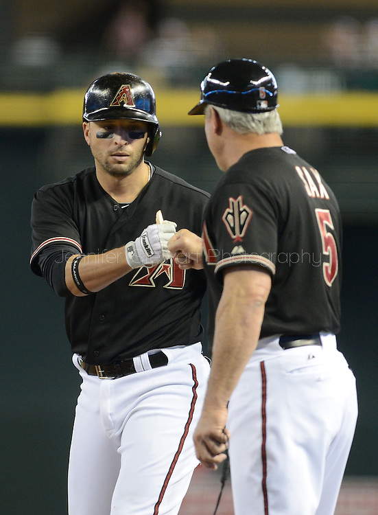 PHOENIX, AZ - MAY 27:  Martin Prado #14 of the Arizona Diamondbacks is congratulated by first base coach Steve Sax against the Texas Rangers in the first inning of an interleague game at Chase Field on May 27, 2013 in Phoenix, Arizona.  (Photo by Jennifer Stewart/Getty Images) *** Local Caption *** Martin Prado; Steve Sax