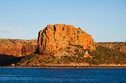 The late afternoon sun lights up the cliffs at Raft Point in Doubtful Bay on the Kimberley coast.