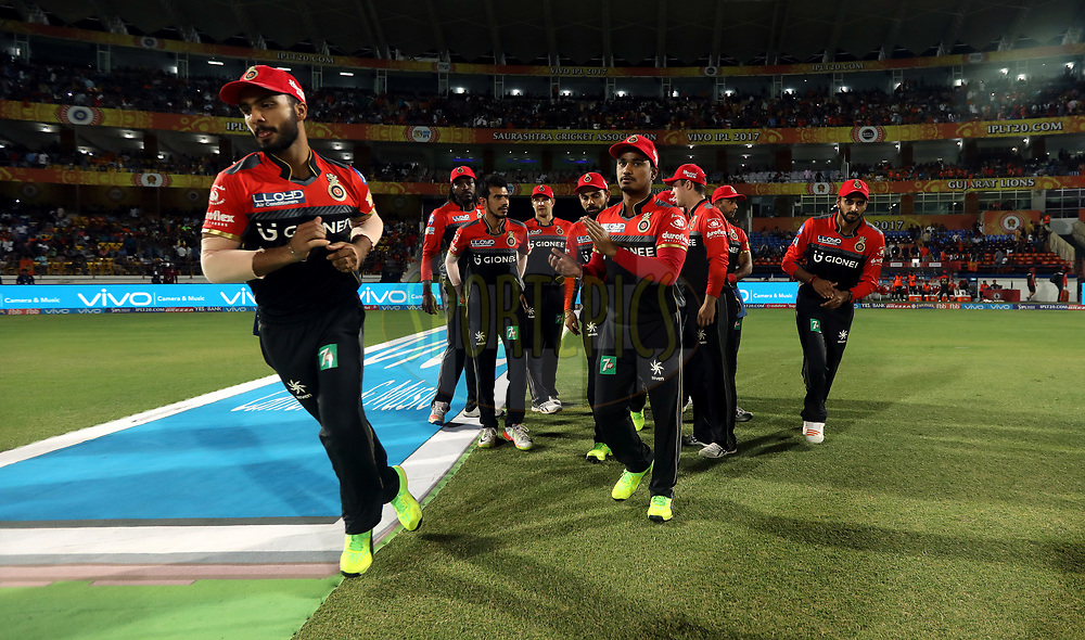Royal Challengers Bangalore players arrive for the start of the second innings during match 20 of the Vivo 2017 Indian Premier League between the Gujarat Lions and the Royal Challengers Bangalore  held at the Saurashtra Cricket Association Stadium in Rajkot, India on the 18th April 2017<br /> <br /> Photo by Sandeep Shetty - Sportzpics - IPL