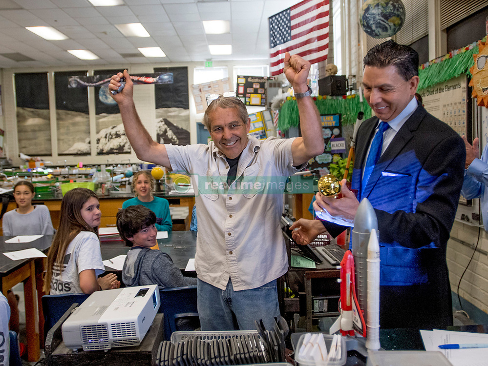 May 2, 2017 - Newport Beach, California, USA - Jim Blackie reacts as he is surprised with a 2018 Teacher of the Year award from the Orange County Department of Education in Newport Beach, California, on Tuesday, May 2, 2017. ..Blackie, an 8th grade science teacher at Ensign Intermediate School, is one of six teachers who were surprised with the honor by county superintendent of school Dr. Al Mija?res. ..(Photo by Jeff Gritchen, Orange County Register/SCNG) (Credit Image: © Jeff Gritchen, Jeff Gritchen/The Orange County Register via ZUMA Wire)