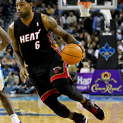 November 5, 2010; New Orleans, LA, USA;  Miami Heat small forward LeBron James (6) drives past New Orleans Hornets center Emeka Okafor (50) during a game at the New Orleans Arena. The Hornets defeated the Heat 96-93. Mandatory Credit: Derick E. Hingle