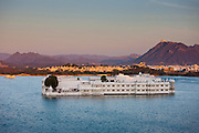The Lake Palace Hotel, Jag Niwas, on island site on Lake Pichola in first light of early morning, Udaipur, Rajasthan, India
