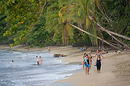 Tourists on main beach, Cahuita National Park, Caribbean coast, Costa Rica.<br />