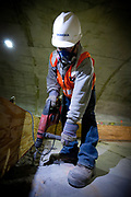 A construction worker drills concrete in the future station as part of the extension of the 7 line of the New York subway system. The tunnel and the 34th street station is well on its way to be finished. A proposed extension to New Jersey is in the talks.