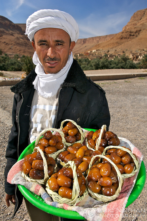 A Moroccan man selling dates near the village of Ziz, Morocco.