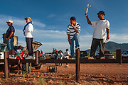 17 APRIL 2005 - NACO, AZ: Christians on the Mexican side of the US/Mexico border demonstrate in support of migrants' rights. The Christians had gathered to protest the presence of the  Minuteman Project in Naco. The Minuteman volunteers were hunting migrants who crossed the border outside of Naco.      PHOTO BY JACK KURTZ