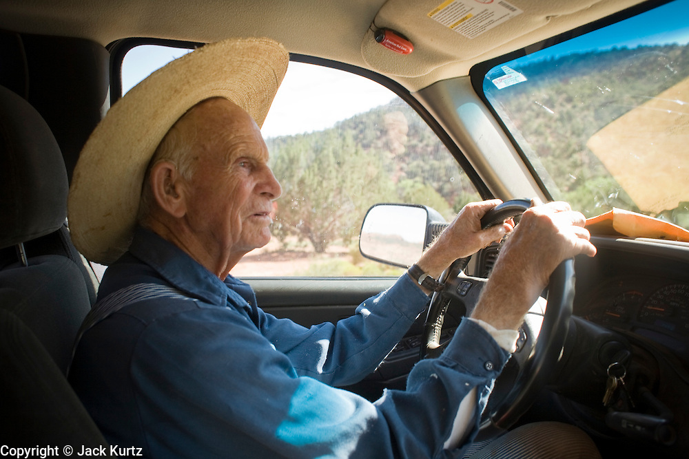 """Aug 9, 2008 -- COLORADO CITY, AZ: JOSEPH JESSOP, 86, patriarch of the Jessop family, polygamists and members of FLDS in Colorado City, AZ, drives his pickup truck through town. Colorado City and neighboring town of Hildale, UT, are home to the Fundamentalist Church of Jesus Christ of Latter Day Saints (FLDS) which split from the mainstream Church of Jesus Christ of Latter Day Saints (Mormons) after the Mormons banned plural marriage (polygamy) in 1890 so that Utah could gain statehood into the United States. The FLDS Prophet (leader), Warren Jeffs, has been convicted in Utah of """"rape as an accomplice"""" for arranging the marriage of teenage girl to her cousin and is currently on trial for similar, those less serious, charges in Arizona. After Texas child protection authorities raided the Yearning for Zion Ranch, (the FLDS compound in Eldorado, TX) many members of the FLDS community in Colorado City/Hildale fear either Arizona or Utah authorities could raid their homes in the same way. Older members of the community still remember the Short Creek Raid of 1953 when Arizona authorities using National Guard troops, raided the community, arresting the men and placing women and children in """"protective"""" custody. After two years in foster care, the women and children returned to their homes. After the raid, the FLDS Church eliminated any connection to the """"Short Creek raid"""" by renaming their town Colorado City in Arizona and Hildale in Utah. Photo by Jack Kurtz / ZUMA Press"""